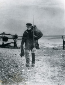 Ron Green's Great Grandfather Abraham 'Ham' Green 1838-1910. He fished off the beach - for eels on this occassion, as he is carrying eel shears.